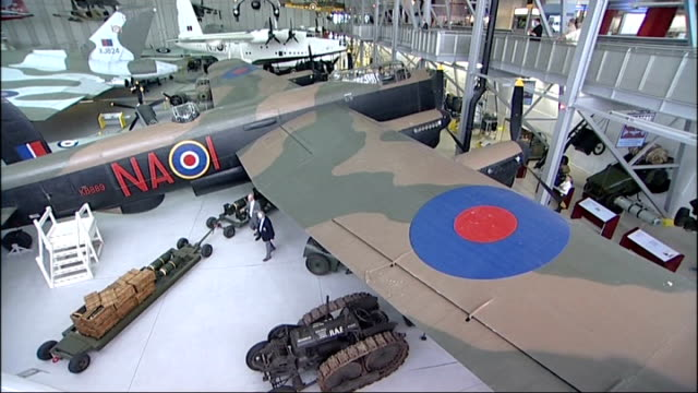 preview of unveiling of bomber command war memorial in london england duxford imperial war museum int high angle gv of lancaster bomber on display as... - lancaster bomber stock videos & royalty-free footage