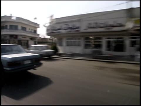 Prewar Iraq / Car POV driving through Iraq streets / Iraq