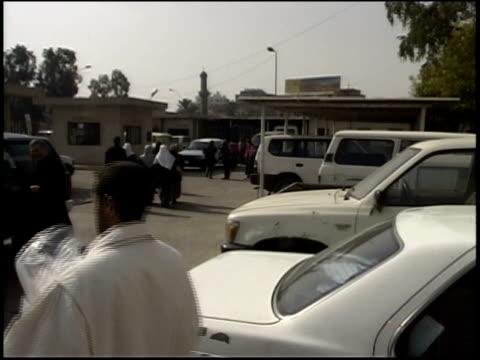 prewar iraq / ws crowd scene / ms republican guard officers in uniform / ms iraqi men giving peace sign to camera / iraq / audio - iraq stock videos and b-roll footage
