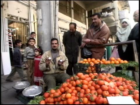 Prewar Iraq / WS Street market scenes / MS Fruit vendors and fish mongers / Iraq