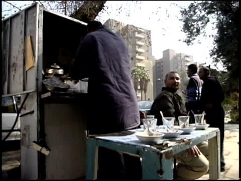 Prewar Iraq / WS Street scene / Street vendor preparing tea / Iraq