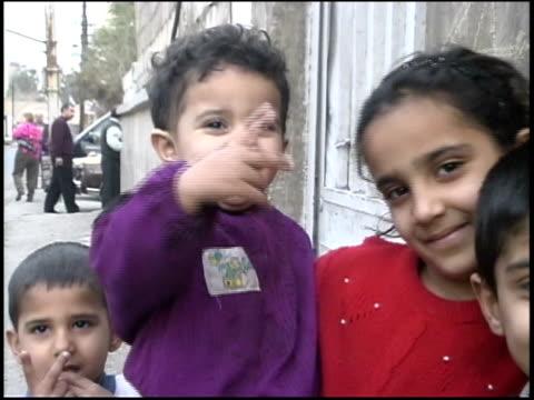 prewar iraq / ws ms street scenes of iraqi children / iraq - middle eastern culture stock videos & royalty-free footage