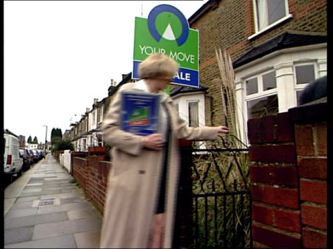 price boom over; itn lib couple shown into house by estate agent couple looking at kitchen of house - itv late evening bulletin点の映像素材/bロール