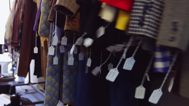 price tags swinging on coats in vintage fashion store - second hand stock videos & royalty-free footage