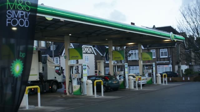prices for unleaded and diesel fuel sit displayed on a sign on the forecourt of a gas station operated by bp plc in london uk on tuesday jan 14 a bp... - unleaded stock videos and b-roll footage