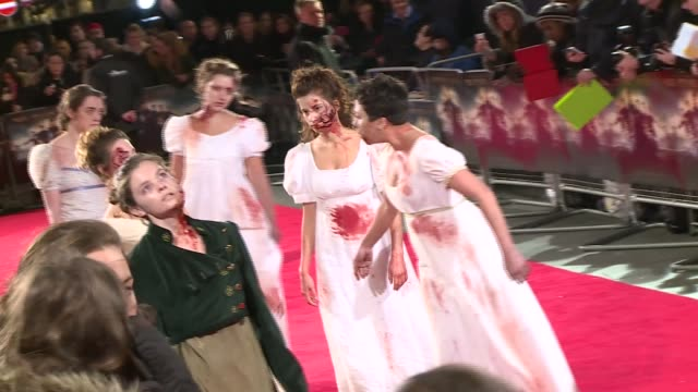 pride and prejudice and zombies film premiere; england: london: ext poster for film / fans behind barriers / zombies on red carpet / director burr... - julian fellowes stock videos & royalty-free footage
