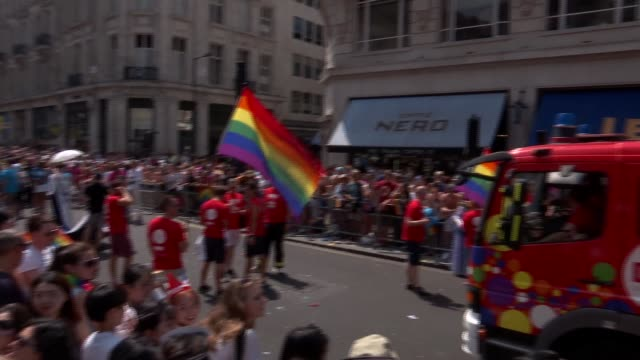 pride in london march 2018 gvs and sadiq khan interview england london ext various of pride in london march including fire engine in rainbow colours... - marching stock videos and b-roll footage