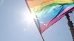 Pride LGBT rainbow flag waving in slow motion during a pride parade