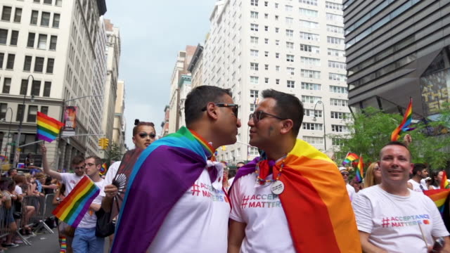 pride march two asian men kiss at worldpride nyc 2019 on june 30 2019 in new york city - gay pride stock videos & royalty-free footage