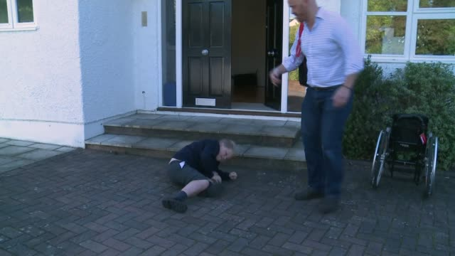 pride of britain award finalists: duchenne muscular dystrophy fundraiser alex smith; england: surrey: int alex smith helping his young son harrison... - spielkandidat stock-videos und b-roll-filmmaterial