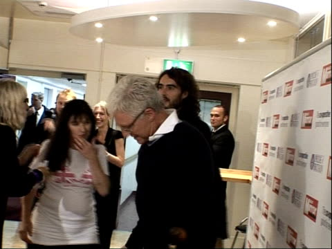 arrivals and interviews award winner nina barough posing for photocall with russell brand and paul o'grady nina barough paul o'grady and russell... - paul o'grady stock-videos und b-roll-filmmaterial