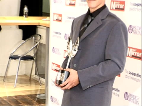 Arrivals and interviews Award winner Carl Duval posing with award and joined by Emma Bunton and Geri Halliwell