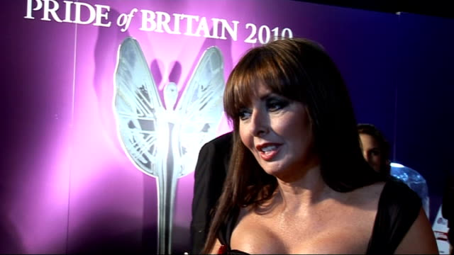 stockvideo's en b-roll-footage met red carpet arrivals and interviews carol vorderman interview sot on rehearsing for awards show / on simon cowell why we love him very charming man - charmant