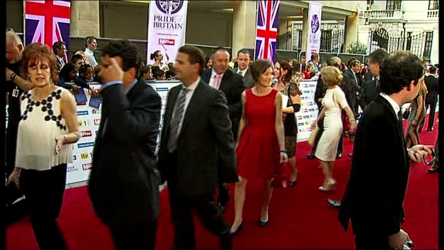 red carpet arrivals and interviews england london ext crowd along red carpet / fans with cameras behind barriers / various of people along red carpet... - paul o'grady stock videos & royalty-free footage