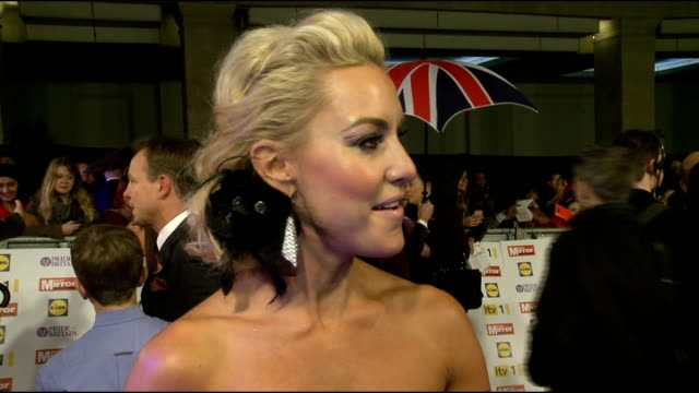 stockvideo's en b-roll-footage met red carpet arrivals amanda holden interview sot natalie lowe interview sot brief shots of louis smith / obscured shot of dermot o'leary signing... - signeren