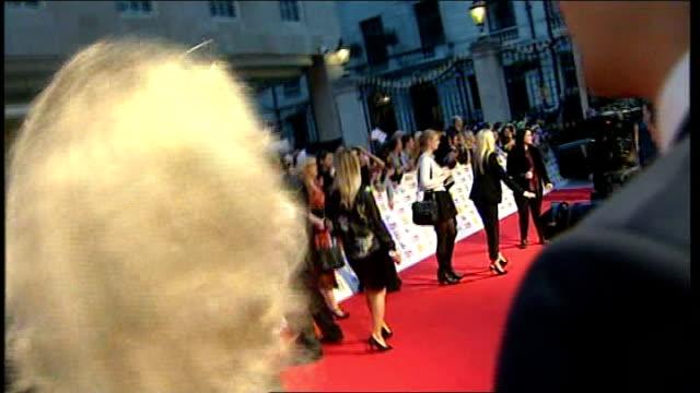 pride of britain awards 2013: arrivals and interviews; ed miliband mp and wife justine thornton arriving and posing for press / miliband signing... - vanessa feltz stock videos & royalty-free footage