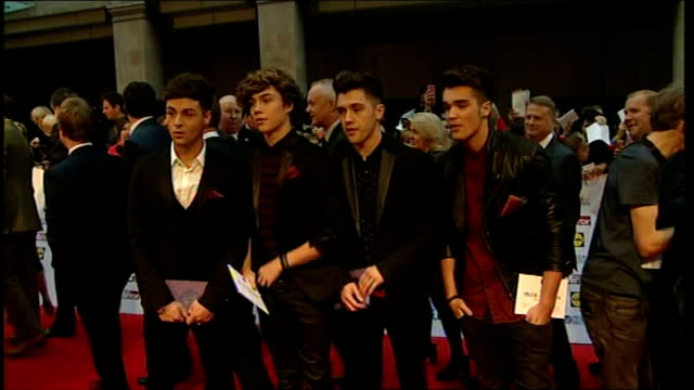pride of britain awards 2013: arrivals and interviews; union j interviewed sot more red carepet arrivals including; oritse williams / natasha... - グロリア ハニフォード点の映像素材/bロール
