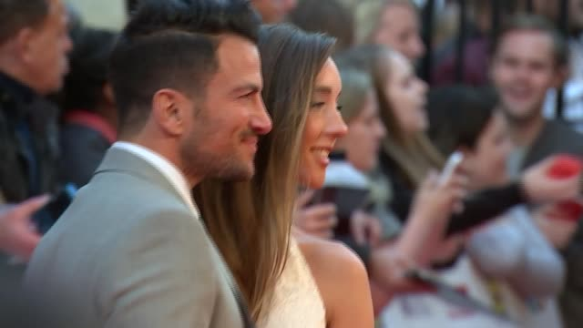 stockvideo's en b-roll-footage met arrivals and interviews little mix group along to speak to press and more posing on red carpet / peter andre and wife emily macdonagh on red carpet /... - former