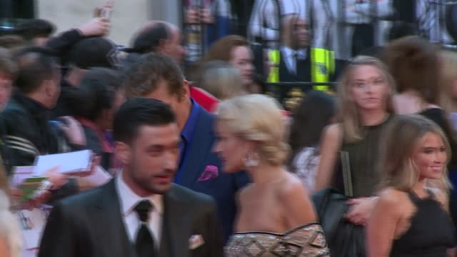 pride of britain awards 2015: celebrity arrivals and interviews; aston merrygold on red carpet / other celebrity arrivals including presenters eamonn... - エイモン ホームズ点の映像素材/bロール