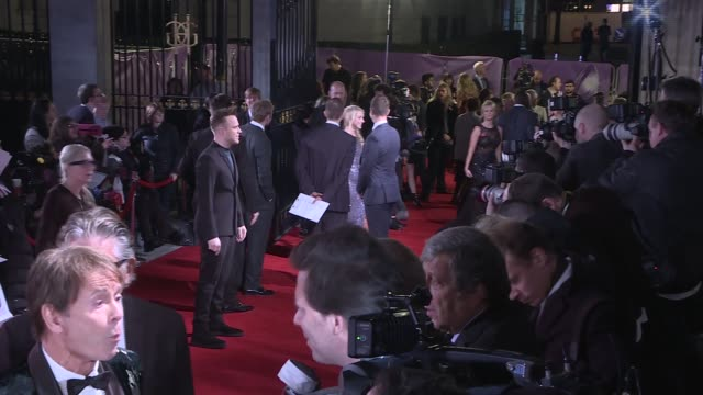 pride of britain awards 2016: red carpet arrivals and interviews; cliff richard and gloria hunniford along red carpet / cliff richard and gloria... - gloria hunniford stock-videos und b-roll-filmmaterial