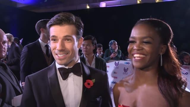 pride of britain awards 2016: red carpet interviews; england: london: ext / night laura whitmore on red carpet danny mac and oti mabuse interview sot... - ストリクトリーカムダンシング点の映像素材/bロール