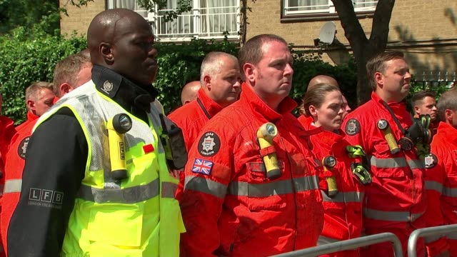 Preview R190617038 / 1962017 Kensington Firefighters and Red Cross workers lined up to pay their respects to victims of Grenfell Tower fire END LIB