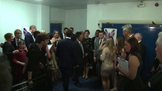 Prince William attends and meets winners Prince William in room with Pride of Britain Award winners / William along up stairs