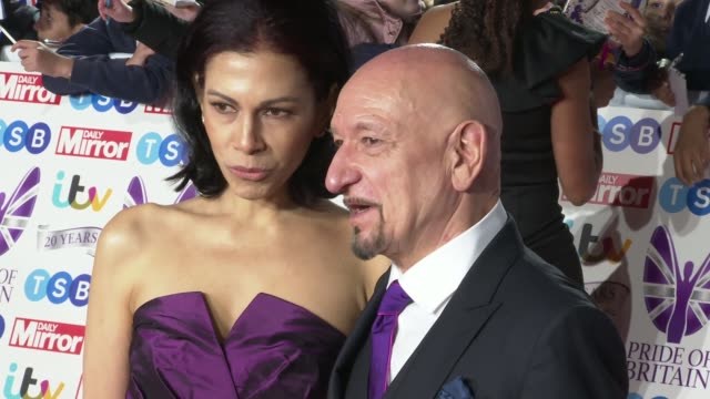 red carpet arrivals england london grosvenor house photography** sir ben kingsley and wife daniela lavender posing / alexandra burke and boyfriend... - ben kingsley stock videos & royalty-free footage