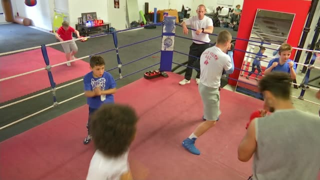 winners billy monger and dale youth boxing club t17071743 / tx london **mick delaney interview overlaid sot** various shots of children training in... - youth club stock videos & royalty-free footage