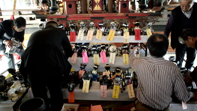 """a priest and three sony aibo robotic dogs recited sutras in a funeral service to mourn the """"souls"""" of 71 of their broken buddies at the kofukuji... - priest stock videos & royalty-free footage"""