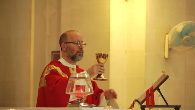 priest at church - malta - church stock videos & royalty-free footage