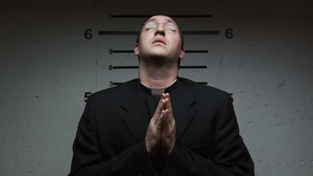 a priest being booked for a crime - pastor stock videos & royalty-free footage