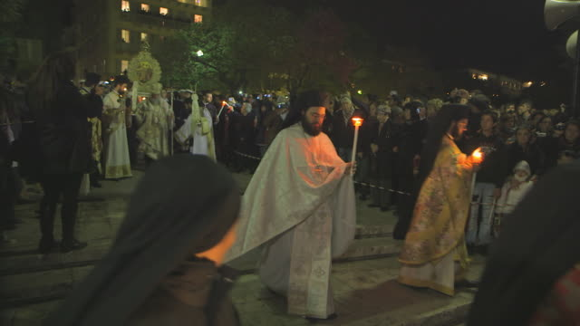 ms priest carrying of holy symbol on easter parade at night audio / kerkyra, corfu, greece - easter stock videos & royalty-free footage