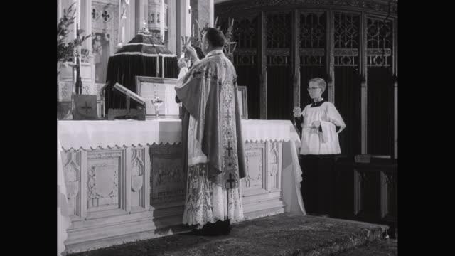 MS Priest celebrating mass in church / United States