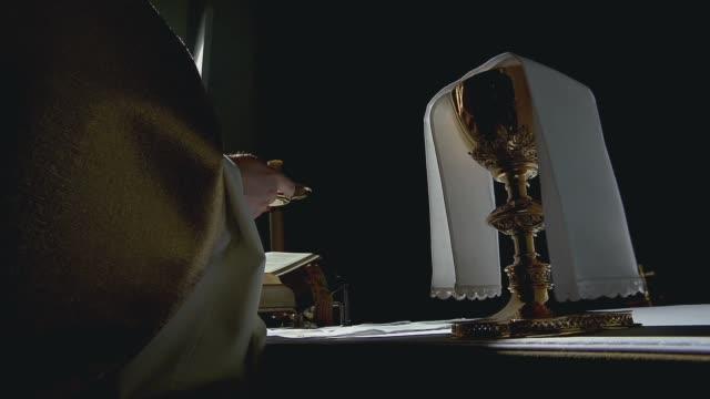 priest celebrating mass - religious mass stock videos & royalty-free footage