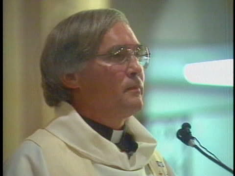 a priest delivers a eulogy in houston texas at the memorial service for plane crash victim us representative mickey leland - eulogy stock videos & royalty-free footage