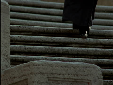 Priest descends stone steps Vatican City