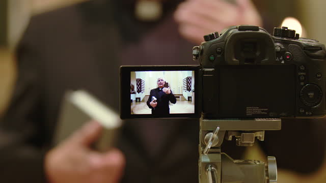 priest giving online sermon during covid-19 crisis - pastor stock videos & royalty-free footage