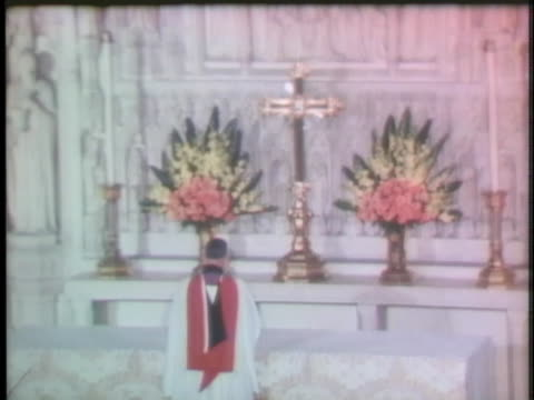 priest in washington, d.c., celebrates mass in thanksgiving for the safe return of apollo 13 from its dangerous aborted space mission. - religious service stock videos & royalty-free footage