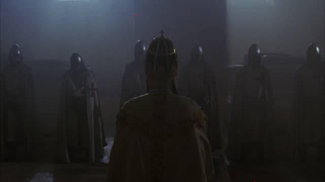 a priest offers a blessing for a group of knights before battle. - periodo medievale video stock e b–roll