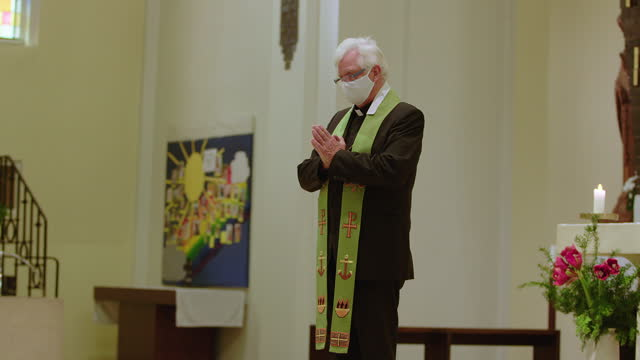 priest praying in church during covid-19 - pastor stock videos & royalty-free footage