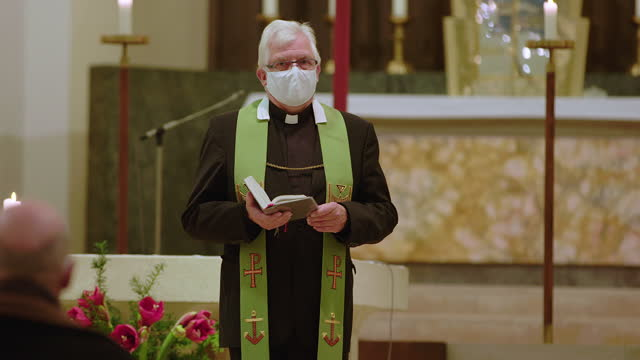 priest preaching in cathedral during covid-19 - pastor stock videos & royalty-free footage