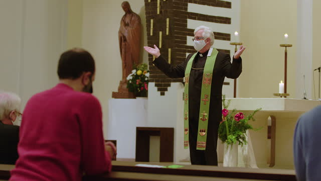 priest preaching in church during covid-19 - pastor stock videos & royalty-free footage