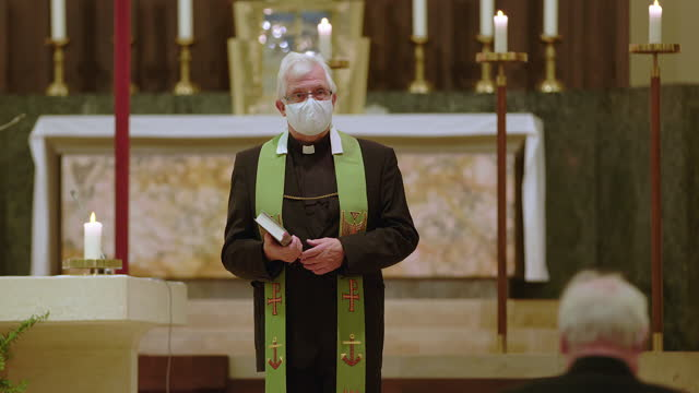 priest preaching in church during covid-19 - priest stock videos & royalty-free footage