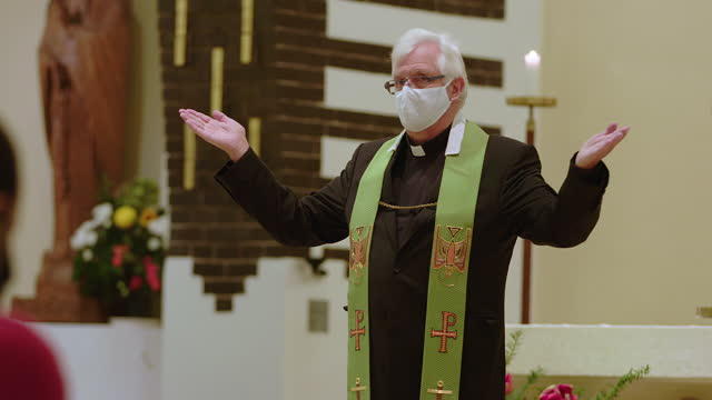 priest preaching in church during pandemic - pastor stock videos & royalty-free footage