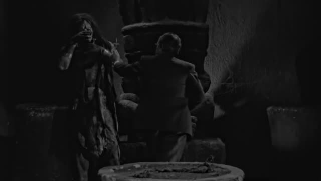 priest shows a cross to the mummy. then the pyramid starts to collapse. - monster fictional character stock videos & royalty-free footage