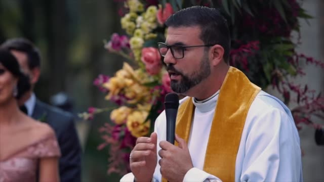 priest talking and celebrating a wedding ceremony - christianity stock videos & royalty-free footage