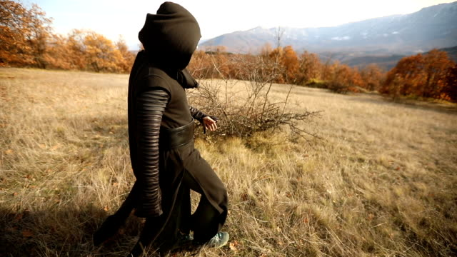 priest walking in nature - cappuccio video stock e b–roll