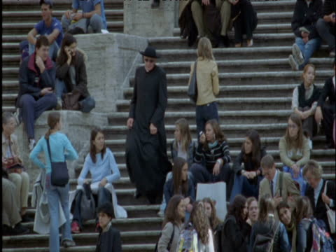priest weaves between crowd on steps rome - minister clergy stock videos and b-roll footage