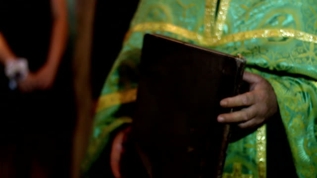 priest with bible - anglican stock videos & royalty-free footage
